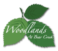 The Woodlands at Bear Creek logo
